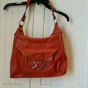 Ladies handbag with inside zippered pocket.